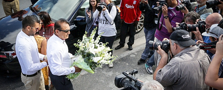The Hindocha family faces a large group of photographers upon arriving in Khayelitsha to mark the fourth anniversary of Anni Dewani's murder on 13 November 2014. Picture: Thomas Holder/EWN.