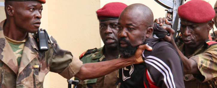 """In this file photo taken on 29 October 2018, members of the armed forces arrest Central African MP Alfred Yekatom aka """"Rambo"""" (C), who represents the southern M'baiki district former militia leader, after he fired the gun at the parliament in Bangui. Picture: AFP."""