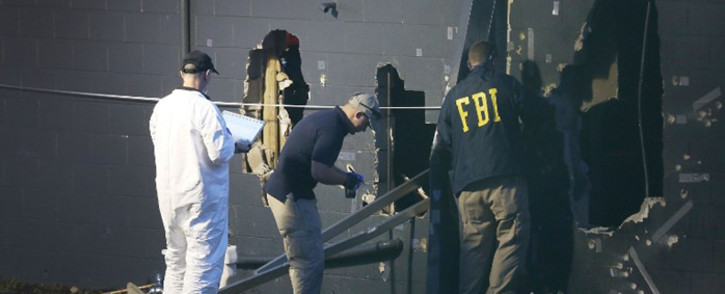 FILE: FBI agents on scene at the Pulse Nightclub where Omar Mateen killed at least 50 people on 12 June, 2016 in Orlando, Florida. Picture: AFP.