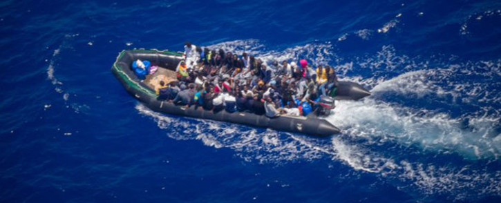 FILE: Migrants in an inflatable rubber dinghy. Picture: @seawatch_intl/Twitter
