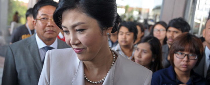 Thai Prime Minister Yingluck Shinawatra is surrounded by media at the Army Club in Bangkok on 10 December, 2013. Picture: AFP