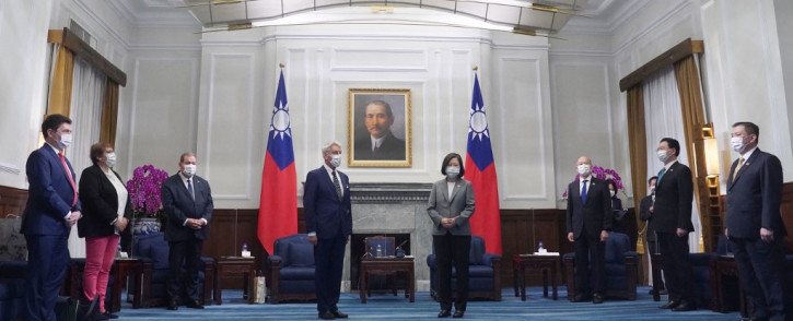Taiwan President Tsai Ing-wen (4th R) greets French Senator Alain Richard (4th L) and the French delegation at the Presidential Office in Taipei on 7 October 2021. Picture: AFP