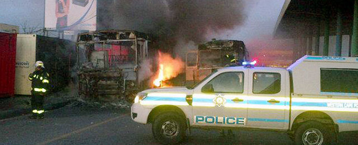 Golden Arrow buses were set alight during protests in Nyanga on 1 September 2014. Picture: @lama_benge via Twitter.