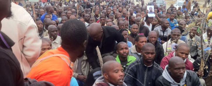 Lonmin miners make their way through Marikana, as they march, demanding better salaries. Picture: Taurai Maduna/EWN