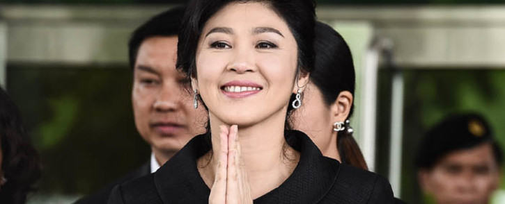 This file photo taken on July 21, 2017 shows former Thai prime minister Yingluck Shinawatra greeting her supporters as she leaves the Supreme Court in Bangkok. Picture: AFP