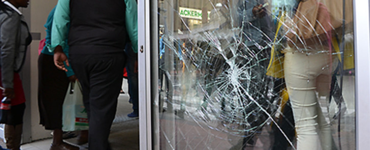 FILE: Damage to an Adderley Street shop front after protesters demonstrated in in the Cape Town CBD on 30 October 2013. Picture: Aletta Gardner/EWN