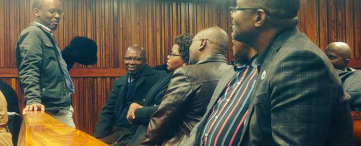 National Union of Metalworkers of South Africa and Cosatu members sit inside Johannesburg High Court ahead of the court hearing after Numsa made calls to be reinstated back to Cosatu on 9 June 2015. Picture: Govan Whittles/EWN.