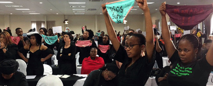 Women hold up underwear at the gender-based violence summit during President Cyril Ramaphosa's address on 1 November 2018. Picture: Sethembiso Zulu/EWN.