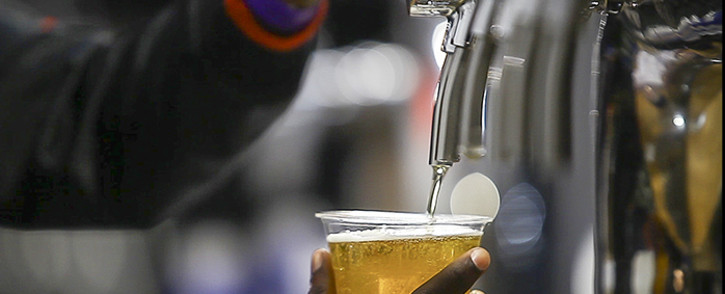 FILE: A bartender pours a draught beer. Picture: EWN.