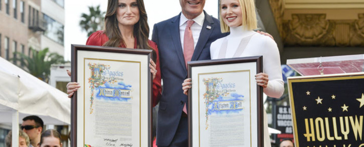 (L-R) Idina Menzel, Los Angeles Mayor Eric Garcetti and Kristen Bell on The Hollywood Walk of Fame on 19 November 2019 in Hollywood, California. Picture: AFP