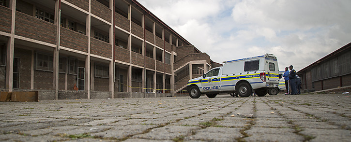 Police guard a burnt classroom which they have cordoned off as a crime scene on 7 September 2016. Picture: Aletta Harrison/EWN