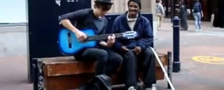 A group of Edgemead High students stunned crowds when they took a seat next to a homeless man and sang along with him in order to collect money on 23 October 2014. Picture: YouTube.