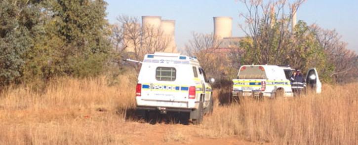 Police investigate the scene where a top Johannesburg policeman's body was found near Hammanskraal, just outside Pretoria, on 18 June 2013. Picture: Christa van der Walt/EWN.