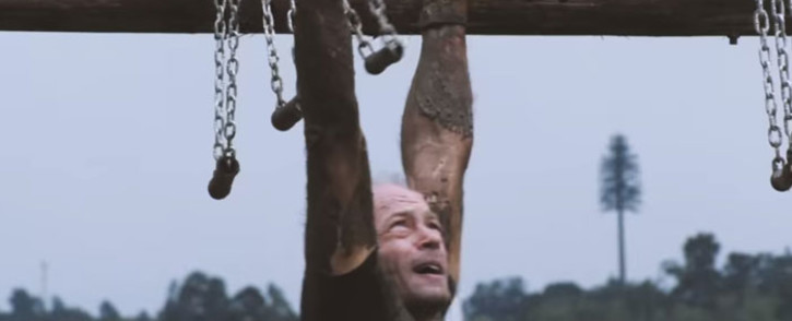 A competitor takes part in an obstacle course race.