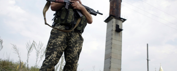 FILE:A Ukrainian soldier stands guard at a check-point near the eastern Ukrainian city of Donetsk on 11 August 2014. Picture: AFP.