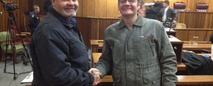 FILE: Boeremag brothers Mike and Andre du Toit congratulate each other after Judge Eben Jordaan convicted Andre of high treason. Picture: Barry Bateman/EWN.