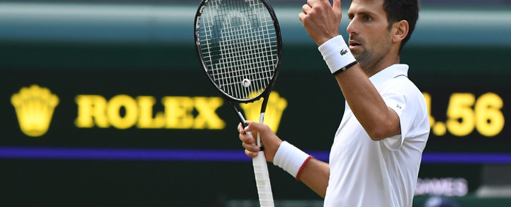 Serbia's Novak Djokovic challenges a call in the fifth set tie breaker against Switzerland's Roger Federer during the men's singles final on day thirteen of the 2019 Wimbledon Championships. Picture: AFP