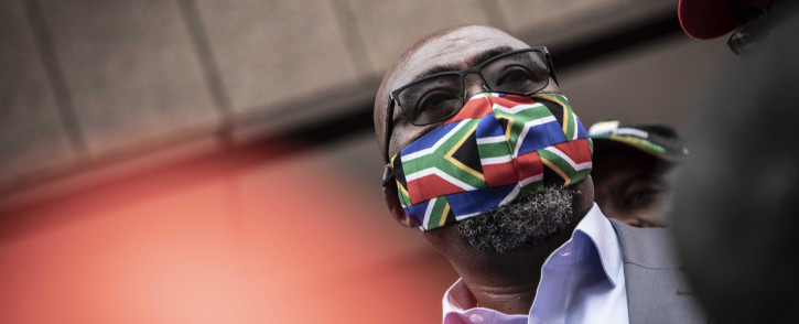 FILE: Labour Minister Thulas Nxesi receives the memorandum from trade union leaders who marched with protesters in Pretoria.  Picture: Abigail Javier/EWN