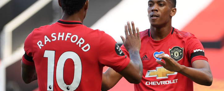 FILE: Manchester United's striker Anthony Martial (R) celebrates scoring the opening goal with teammate Marcus Rashford during the English Premier League football match between Manchester United and Sheffield United at Old Trafford in Manchester, north west England, on 24 June 2020. Picture: AFP