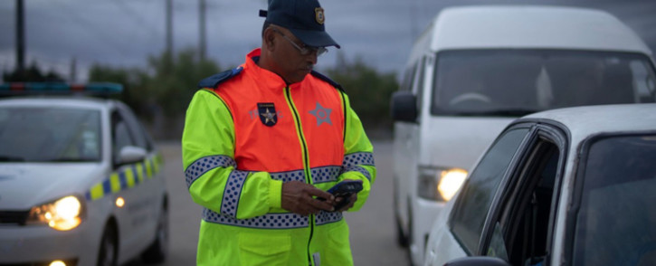 FILE: A Western Cape traffic official conducts vehicle checks and random breath testing operations. Picture: @WCGovSafelyHome/Twitter.