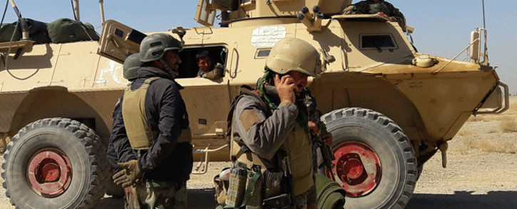 Afghan security forces stand near an armoured vehicle during ongoing fighting between Afghan security forces and Taliban fighters in the Busharan area on the outskirts of Lashkar Gah, the capital city of Helmand province May 5, 2021. Picture: Sifatullah Zahidi / AFP