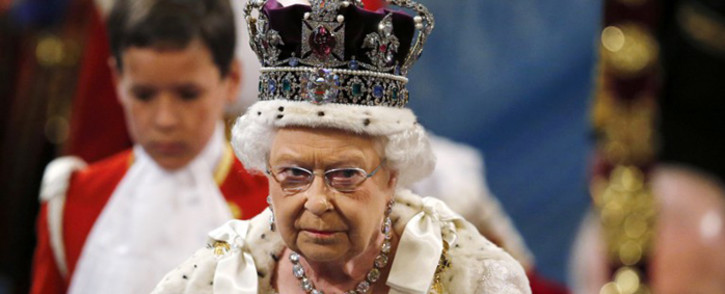 Britain's Queen Elizabeth II, wearing the Imperial State Crown, proceeds through the Royal Gallery during the State Opening of Parliament at the Palace of Westminster in central London on 27 May, 2015. Picture: AFP.