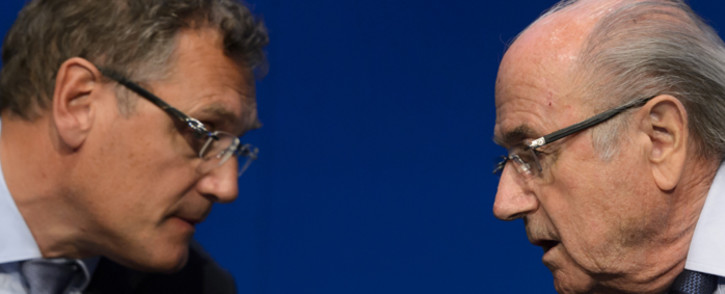 FILE: Fifa president Sepp Blatter speaks with Fifa Secretary General Jerome Valcke during a press conference on 30 May, 2015 in Zurich after being re-elected during the Fifa Congress. Picture: AFP.