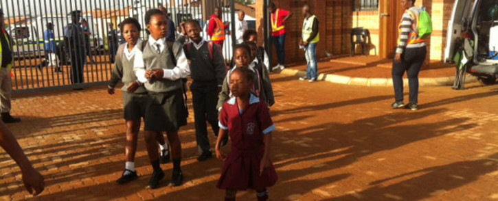 Pupils arrive for their first day of school at the newly built Chief Albert Luthuli Primary School in Daveyton on 13 January 2016. Picture: Kgothatso Mogale/EWN
