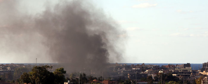 Smoke billows from buildings after the air force from the pro-government forces loyal to Libya's Government of National Unity (GNA) fired rockets targeting Islamic State (IS) group positions in Sirte. Picture: AFP.