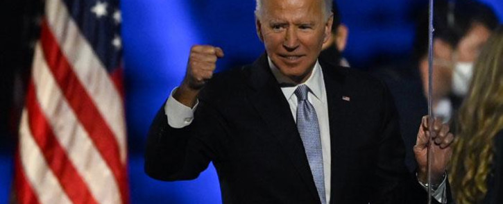 FILE: US President-elect Joe Biden holds up his fist after delivering remarks in Wilmington, Delaware, on 7 November 2020, after being declared the winners of the presidential election. Picture: AFP