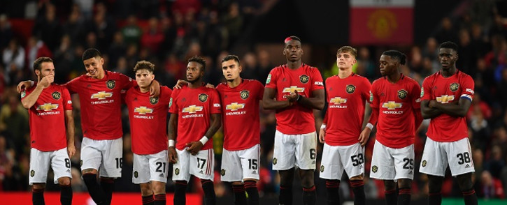 FILE: Manchester United players wait in the centre circle as penalties are taken after the game finishes 1-1 during the English League Cup third round football match between Manchester United and Rochdale at Old Trafford in Manchester, north-west England on 25 September 2019. Picture: AFP