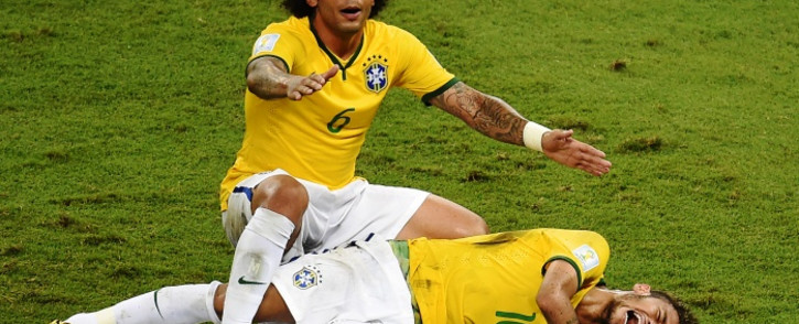 Defender Marcelo shouts for help after Brazil's forward Neymar was injured during the quarter-final football match between Brazil and Colombia. Picture: AFP
