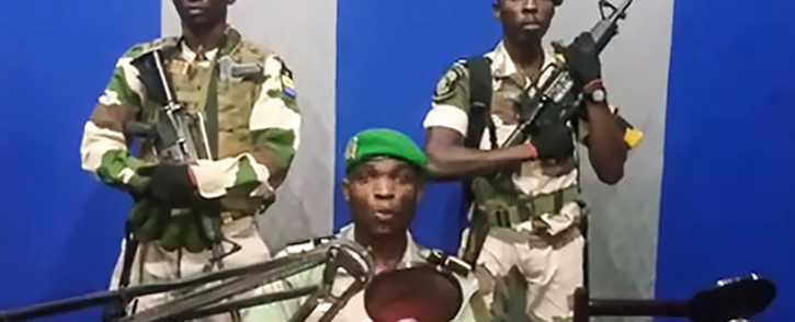 """A screengrab of Gabon soldiers on state radio on 7 January 2019 calling on the people to """"rise up"""" and announced a """"national restoration council"""" would be formed, as an ailing President Ali Bongo is out of the country. Picture: AFP"""