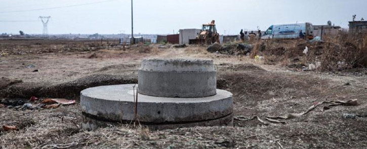 A six-year-old boy fell into this manhole on 5 September 2021 in Orange Farm. The boy and other children were said to be playing at the manhole. Search and rescue teams had yet to find the boy on 6 September 2021. Picture: Abigail Javier/Eyewitness News.