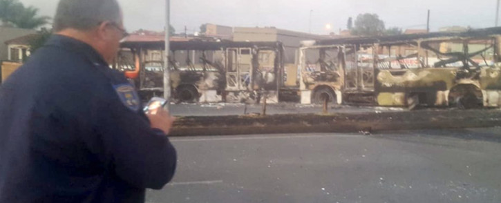 The remains of two buses torched during a protest in Mzimhlophe, Soweto, on 28 May 2019. Picture: @AsktheChiefJMPD/Twitter