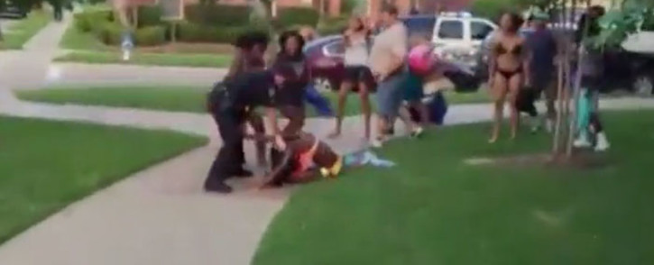 Officials in Mckinney Texas are in damage control mode after a video surfaced showing an officer pointing his gun at unarmed teenagers. Picture: CNN
