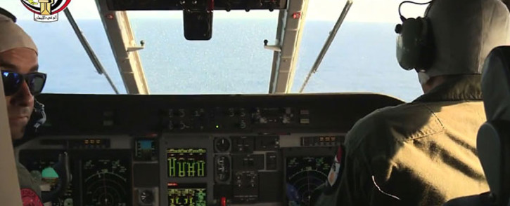 An image grab taken from a handout video released by the Egyptian Defence Ministry on 20 May, 2016 shows Egyptian military pilots taking part in a search mission over the Mediterranean Sea for the remains of an EgyptAir plane which crashed on 19 May, 2016 with 66 people on board, as mystery surrounded its fate despite suspicions of terrorism. Picture: AFP.