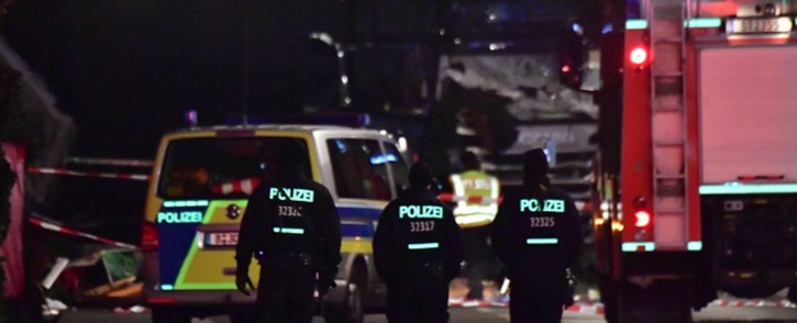 FILE: Police on scene after a truck sped into a Christmas market in Berlin on 19 December 2016. Picture: AFP.