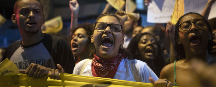 Protester shouts during a demonstration in support and defence of public education following a raft of budget cuts announced by President Jair Bolsonaro's government, in Rio de Janeiro, Brazil, on 30 May 2019.  Picture: AFP