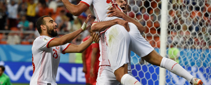 Tunisia's forward Wahbi Khazri (centre) is congratulated by teammates after scoring a goal during the Russia 2018 World Cup Group G football match between Panama and Tunisia at the Mordovia Arena in Saransk on 28 June 2018. Picture: AFP.