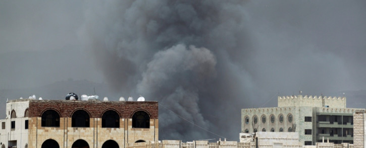 FILE: Smoke billows following an air-strike by the Saudi-led coalition on the headquarters of the Special Security Forces, formerly known as the Central Security, on May 27, 2015, in the Yemeni capital Sanaa. Picture: AFP.