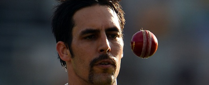 Australia's paceman Mitchell Johnson tosses a ball while approaching his bowling mark during day three of the first Ashes cricket Test match between England and Australia at the Gabba Cricket Ground in Brisbane on November 23, 2013. Source: AFP