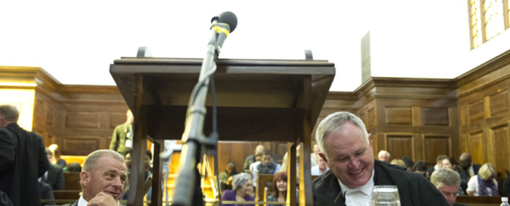 State prosecutor, Gerrie Nel and Barry Roux, sit in court during hearing as the state pleads its case in trying to challenge Oscar Pistorius's culpable homicide conviction on 3 November 2015. Picture: Pool.