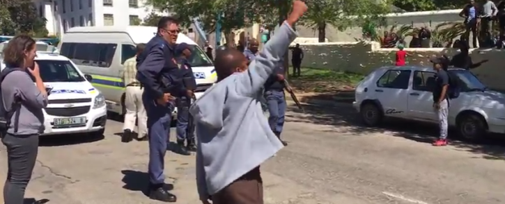 FILE: A video screengrab shows a student leading chanting at Rhodes University on 28 September 2016.