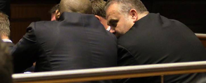 Czech fugitive Radovan Krejcir and co-accused Desai  Luphondo at the Palm Ridge Regional Court during their bail hearing on 4 December 2013. Picture: Christa van der Walt/EWN.
