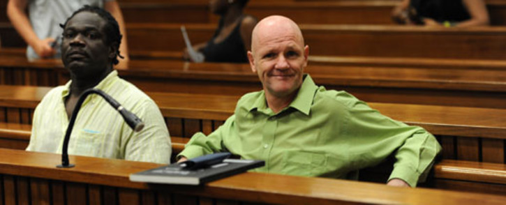Andre Gouws (R) and Ambrose Monye (L) in the North Gauteng High Court on 21 November 2012. Picture: Sapa.