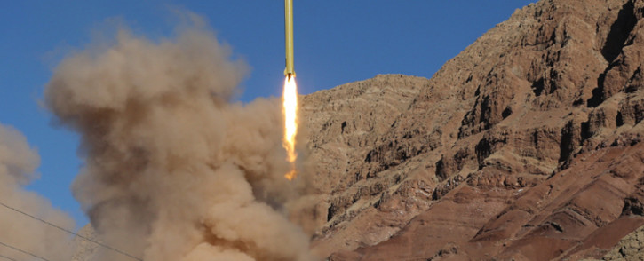 FILE: A ballistic missile is launched in the Alborz mountain range in northern Iran. Picture: AFP.