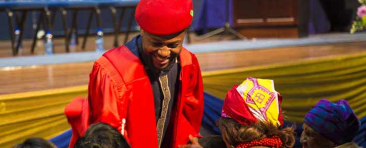 EFF Spokesperson Mbuyiseni Ndlozi enters the Wits University Great Hall for his graduation from PhD in Sociology. Picture: Thomas Holder/EWN.