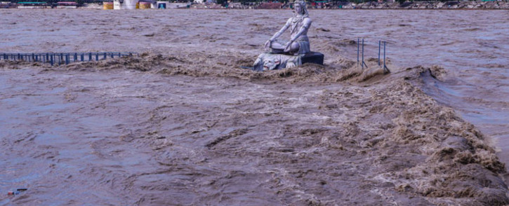 A statue of Hindu god Lord Shiva is pictured amid the risen water levels of River Ganga after incessant rains in Rishikesh in India's Uttrakhand state on 19 October 2021. Picture: AFP