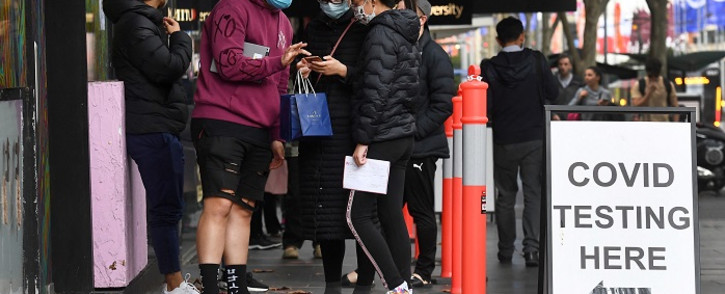 People queue at a Covid-19 testing station in Melbourne on May 25, 2021, as the city recorded five new locally-acquired coronavirus cases in the community after an 85-day unbroken stretch of zero infections. Picture: William West / AFP.